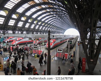 MILAN, ITALY - CIRCA JANUARY 2014: Milano Centrale, Main railway station in Milan with highspeed Frecciarossa trains and passengers