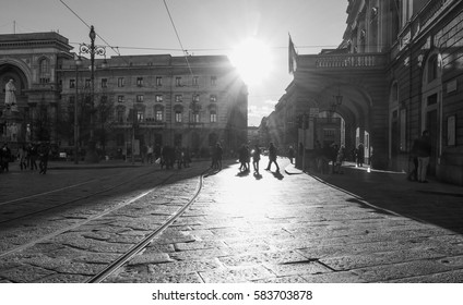 MILAN, ITALY - CIRCA JANUARY 2017: View of the old city centre silhouette against the sun at sunset in black and white