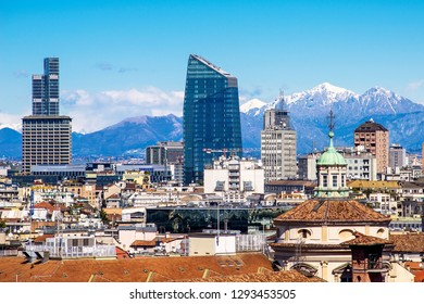 MILAN, ITALY - CIRCA JANUARY 2018: Panoramic view from Duomo roof terrace to Porta Nuova district, the Diamond Tower with in background italian alps, city is in nomination fo the 2026 olimyc games.