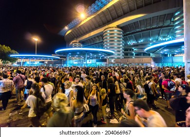 MILAN, ITALY - CIRCA july 2014: Crowd of people outside San Siro football stadium. Stadium is the home of the teams Milan and Inter.