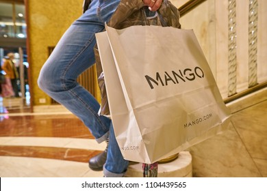 MILAN, ITALY - CIRCA NOVEMBER, 2017: a man stand with a Mango branded shopping bag in Zara store in Milan