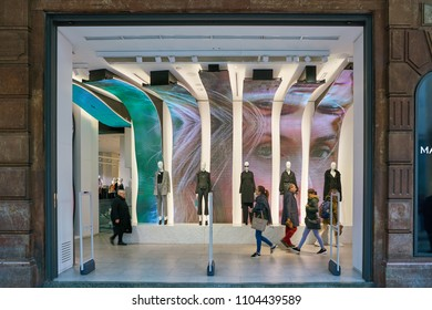 MILAN, ITALY - CIRCA NOVEMBER, 2017: LED Wave Screen display and entrance to a Mango Shop in Milan. MANGO is a Spanish clothing design and manufacturing company.
