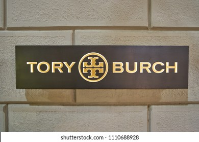MILAN, ITALY - CIRCA NOVEMBER, 2017: close up shot of Tory Burch sign. Tory Burch LLC is an American fashion label owned, operated and founded by American designer Tory Burch.
