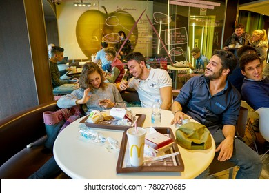 MILAN, ITALY - CIRCA NOVEMBER, 2017: customers eat at a McDonald's restaurant in Milan.