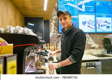 MILAN, ITALY - CIRCA NOVEMBER, 2017: worker at a McCafe coffee shop. McCafe is a coffee-house-style food and beverage chain, owned by McDonald's.