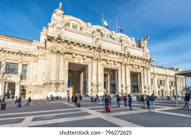 Milan, Italy - December 1, 2016: Milan central train station building  (Stazione Centrale) with people in front of the entrance in the early morning in Milan, Italy.