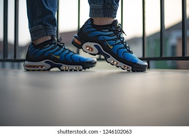 Milan, Italy - December 1, 2018: Young man wearing Nike Air Max Plus TN Hyperblue shoes in the street - illustrative editorial