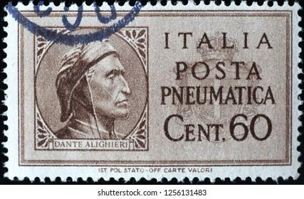 Milan, Italy – December 10, 2018: Dante Alighieri on ancient italian postage stamp