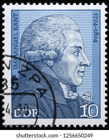 Milan, Italy – December 10, 2018: Philosopher Immanuel Kant on german postage stamp