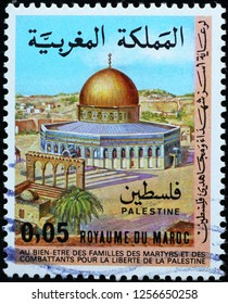 Milan, Italy – December 10, 2018: Mosque in Palestine on moroccan postage stamp