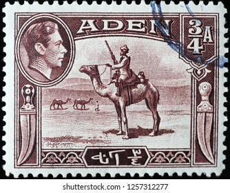 Milan, Italy – December 10, 2018: Soldier on dromedary in old stamp of Aden