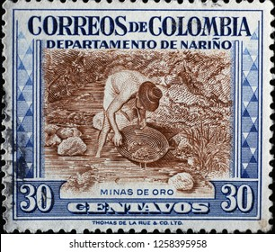 Milan, Italy – December 11, 2018: Gold miner on vintage colombian postage stamp
