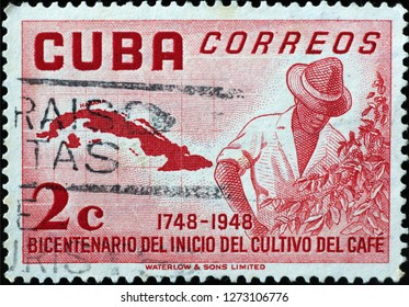 Milan, Italy – December 11, 2018: Man growing coffee plant on vintage cuban postage stamp