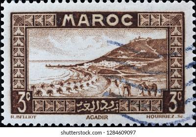 Milan, Italy – December 11, 2018: View of Agadir on vintage moroccan postage stamp
