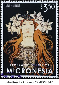 Milan, Italy – December 12, 2018: Sarah Benhardt by Alphonse Mucha on stamp of Micronesia