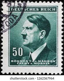 Milan, Italy – December 12, 2018: Adolf Hitler on vintage postage stamp