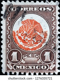 Milan, Italy – December 12, 2018: Mexican coat of arms on old postage stamp