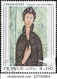 Milan, Italy – December 12, 2018: Painting of woman by Modigliani on postage stamp