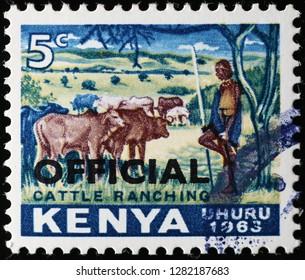 Milan, Italy – December 12, 2018: Kenyan sheperd and cattle on vintage postage stamp