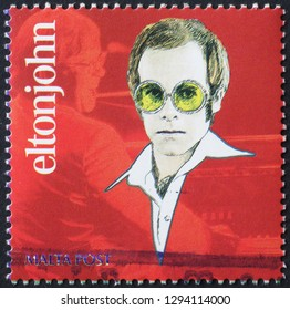 Milan, Italy – December 12, 2018: Drawing of Elton John on postage stamp