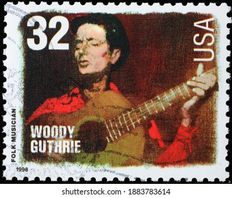 Milan, Italy - December 14, 2020: Woody Guthrie on american postage stamp