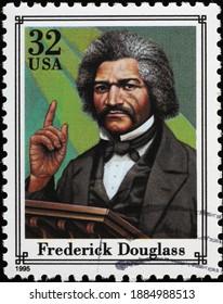 Milan, Italy - December 14, 2020: Frederick Douglass on american postage stamp