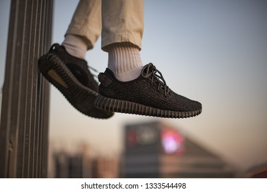Milan, Italy - December 15, 2018: Young man wearing Vans Old Skool shoes in the street - illustrative editorial