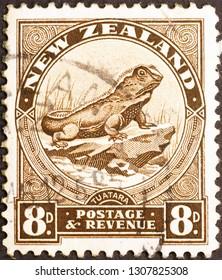 Milan, Italy – December 16, 2014: Lizard Tuatara on New Zealand stamp of 1936