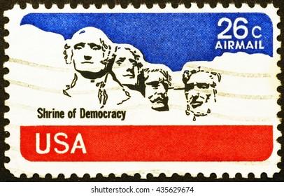 Milan, Italy - December 16, 2014: Mount Rushmore National Memorial on old US postage stamp