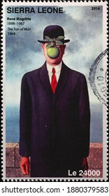Milan, Italy - December 17, 2020: The son of a man by René Magritte on postage stamp