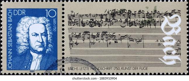 Milan, Italy - December 18, 2020: Original sheet music by Johan Sebastian Bach on postage stamp