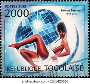 Milan, Italy - December 18, 2020: Donna Summer portrait on african postage stamp