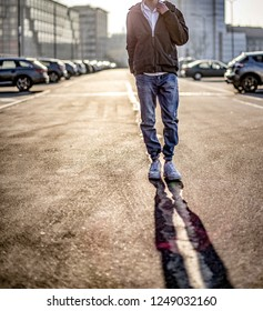 Milan, Italy - December 20, 2017: Young man wearing  Nike Air Force One shoes in the street