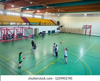 Milan, Italy - december 2018: public school, interior wide basketball court