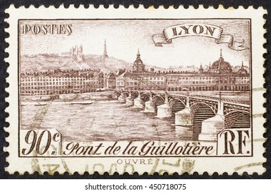 Milan, Italy - December 21, 2013: Old view of Lyon on vintage postage stamp