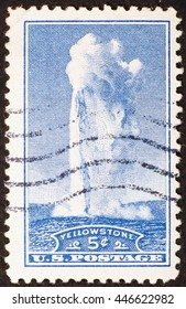 Milan, Italy - December 23, 2013: Vintage stamp celebrating Old Faithful geyser in Yellowstone