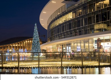 MILAN, ITALY - December 24, 2016: Christmas night in Gae Aulenti square, the new business district named â??Garibaldi Porta Nuovaâ?�