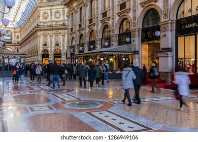 "Milan, Italy - December 8, 2018. In the ""Vittorio Emanuele"" gallery (1867), the oldest Italy's shopping mall, dedicated to Victor Emmanuel II, last king of Piedmont-Sardinia and first king of Italy."