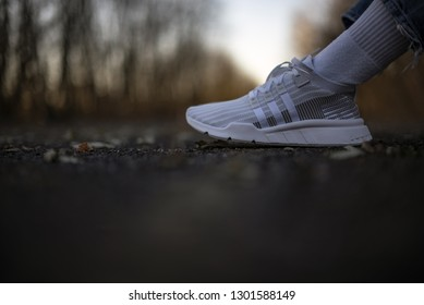 Milan, Italy - December 8, 2018: Man wearing a pair of Adidas Equipment Support Mid ADV PK