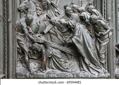 Milan, Italy. Famous landmark - the cathedral door. Jesus Christ, way of the Cross - biblical story.