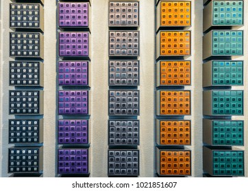 Milan, Italy - Feb 10, 2018: Nespresso coffee capsules of various flavours on display on wall of Nespresso shop in Milan, Italy
