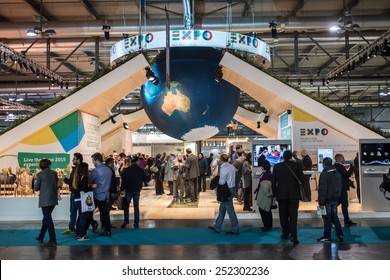MILAN, ITALY - FEB 12: visitors walk in the hall in front of the crowded Expo Milano 2015 World trade show fair design stand during BIT at Rho-Fiera in Milan on February 12, 2015