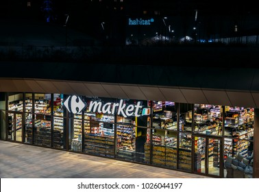 Milan, Italy - Feb 15, 2018: Retail giant, Carrefour supermaket, closed at night in the CityLife district of Milan, Lombardy, Italy