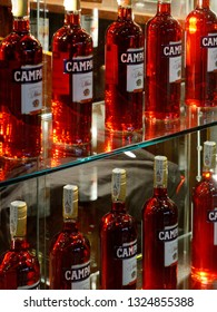 Milan, Italy, Feb 17, 2019: Campari bottles at the Campari shop store window in Corso Vittorio Emanuelle II