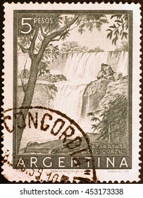 Milan, Italy - February 01, 2014: Iguazu falls in old postage stamp of Argentina
