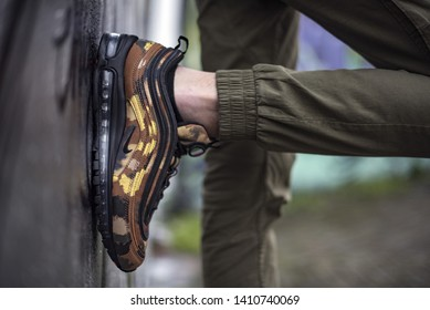 Milan, Italy - February 02, 2018: Man wearing a pair of Nike Air Max 97 Premium Camo Pack Italy in the street