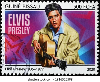 Milan, Italy  - February 05, 2021: Elvis Presley playing guitar on postage stamp