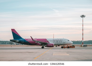 MILAN, ITALY - FEBRUARY 07, 2019: Aircraft Airbus A320-200 HA-LYT of Wizzair parked at Milan Malpensa Airport. It is the largest international airport in the Milan metropolitan area in northern Italy