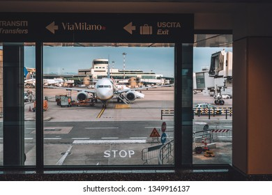 MILAN, ITALY - FEBRUARY 07, 2019: Aircraft parked in Milan Malpensa Airport. It is the largest international airport in the Milan metropolitan area in northern Italy