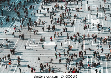 MILAN, ITALY - FEBRUARY 09, 2019: Many people are walking and on Piazza del Duomo square in city centre, top view from the roof cathedral
